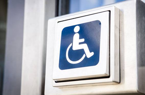 A disabled access button with the disabled person icon.