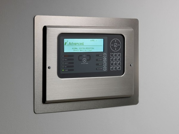 Fire Alarm System Control Panel by 'Advanced Electronics' including logos for Advanced, Apollo and Gent certifications.